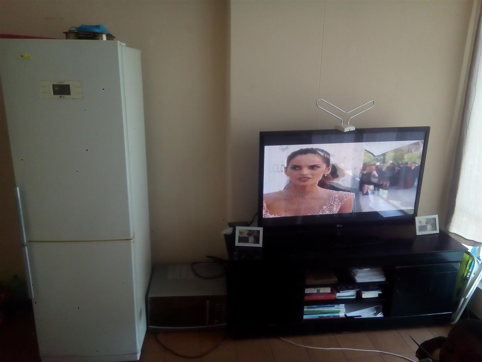 Tv 50 inch LG, Defy microwave, fridge, TV stand and bed