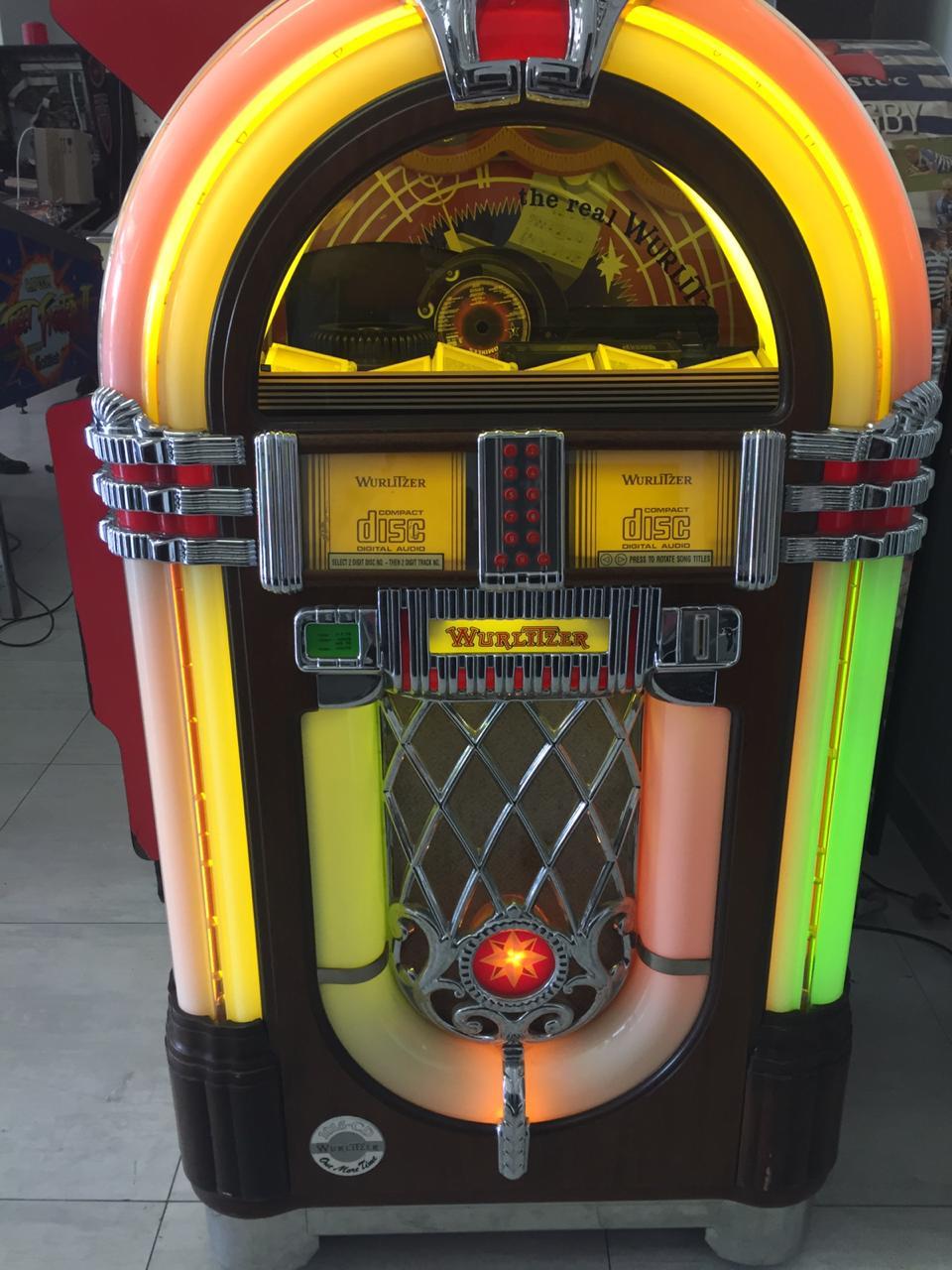 Wurlitzer Model 1015 CD Jukebox Walnut Model for sale in perfect condition  | Junk Mail