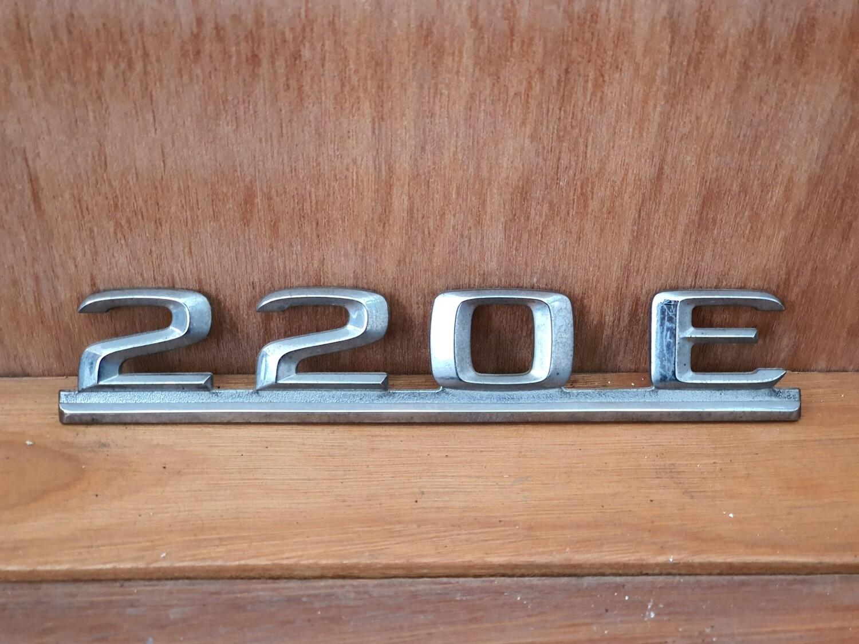 Mercedes-Benz 220E boot badge