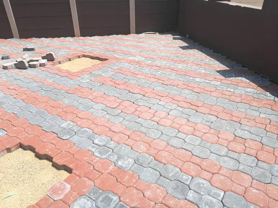 HOT ASPHALT TAR SURFACING AND BRICK PAVING{INDUSTRIAL AND RESIDENTIAL AREAS}