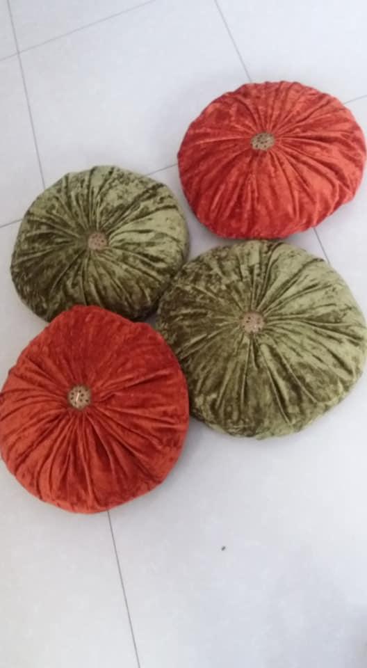 Red and green pumpkin cushions