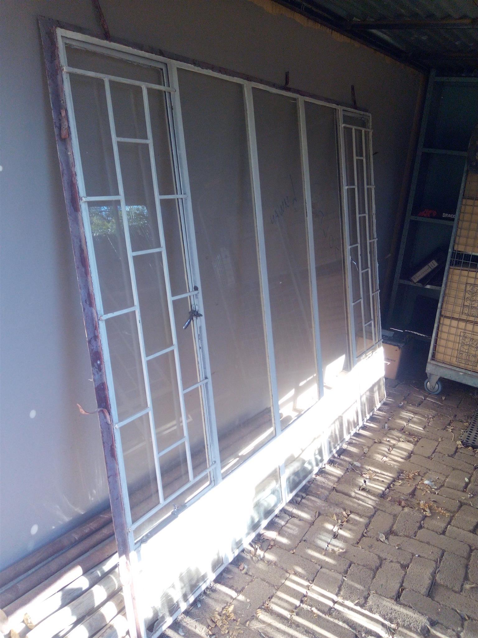 TWO WINDOWS WITH BURGLAR BARS