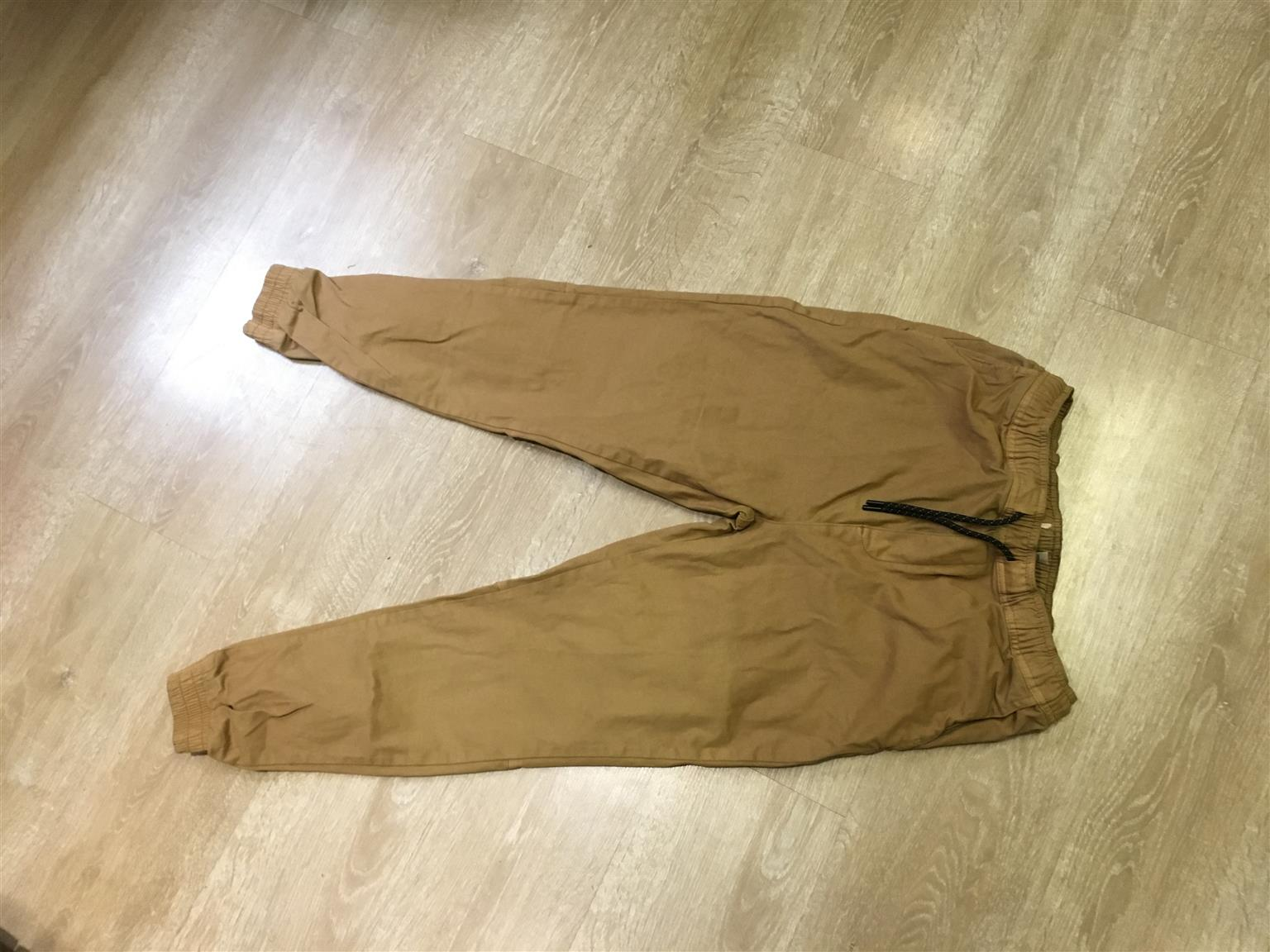 Cuffed pants for sale.