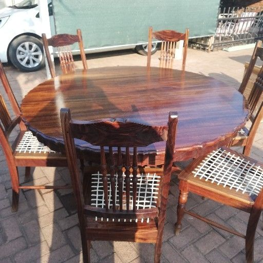 Emboia wood, table and chairs and blackwood buffet
