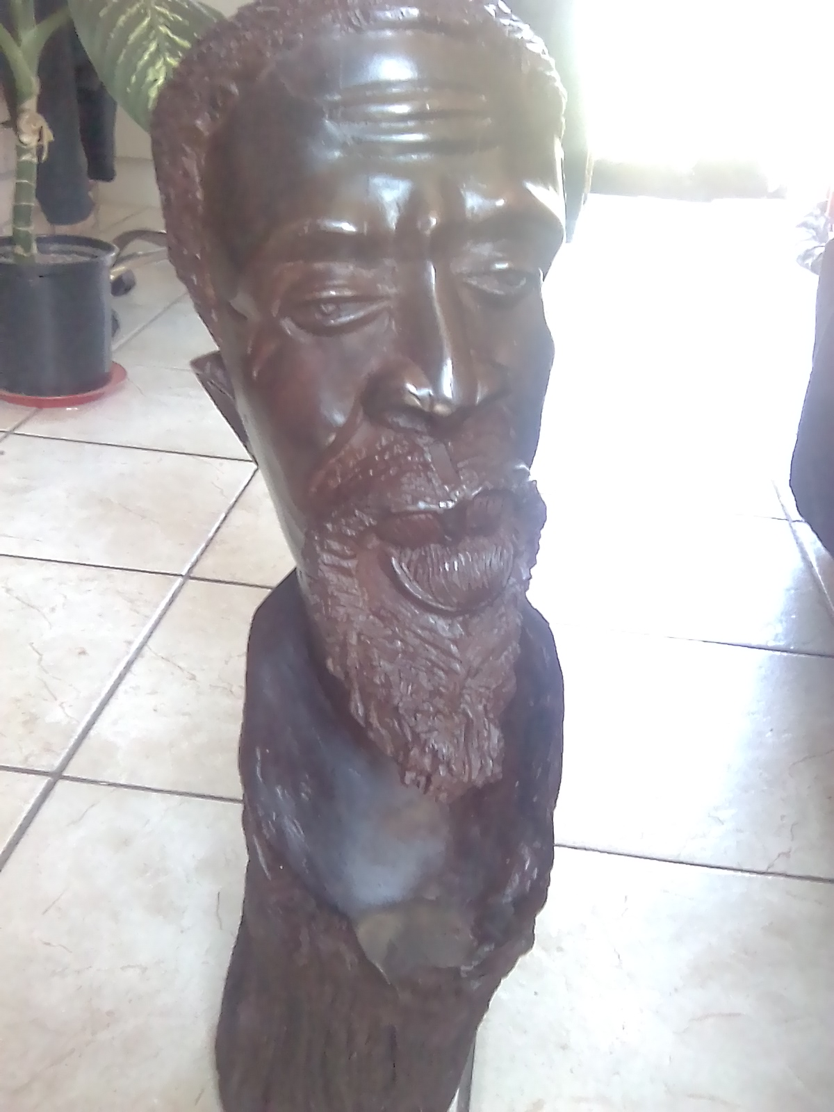 Carved wooden head of african man