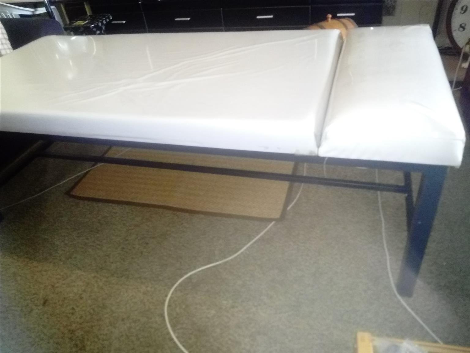 Massage bed with thick matress R 1800.