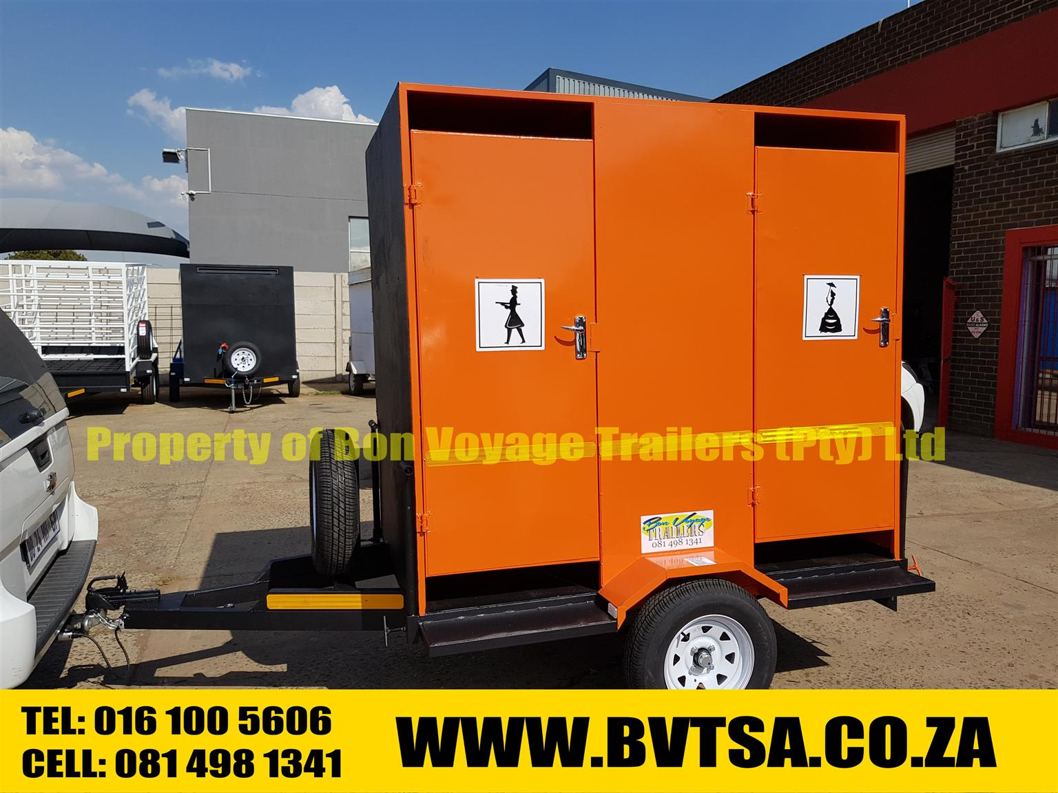 Orange toilet trailer