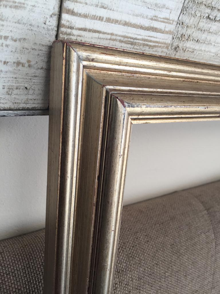 Gilded picture frame with detailed relief pattern
