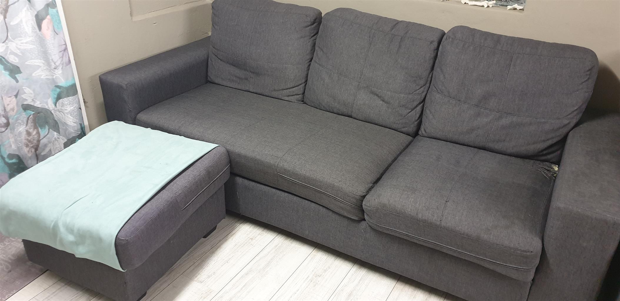 3 1/2 Used grey seater couch 2 years old
