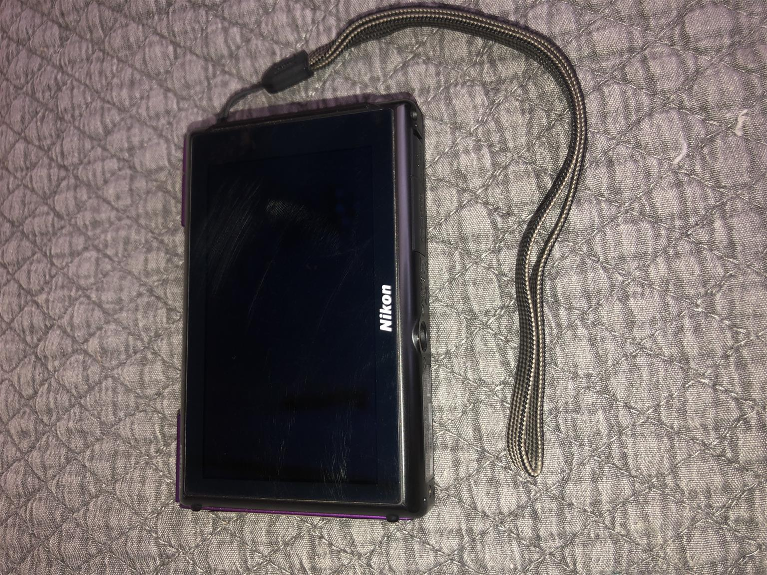 Nikon CoolPix S100 Digital Camera (Purple)  (Price: Negotiable)