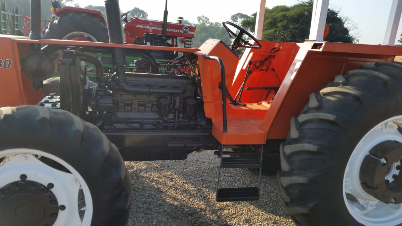 Orange Fiat 980 73KW/98HP 4x4 Pre-Owned Tractor