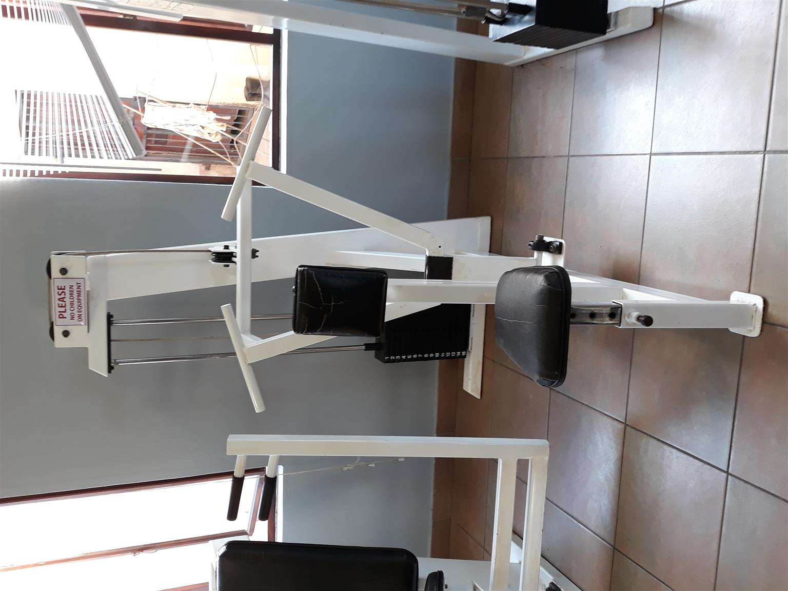 Seated row industrial machine