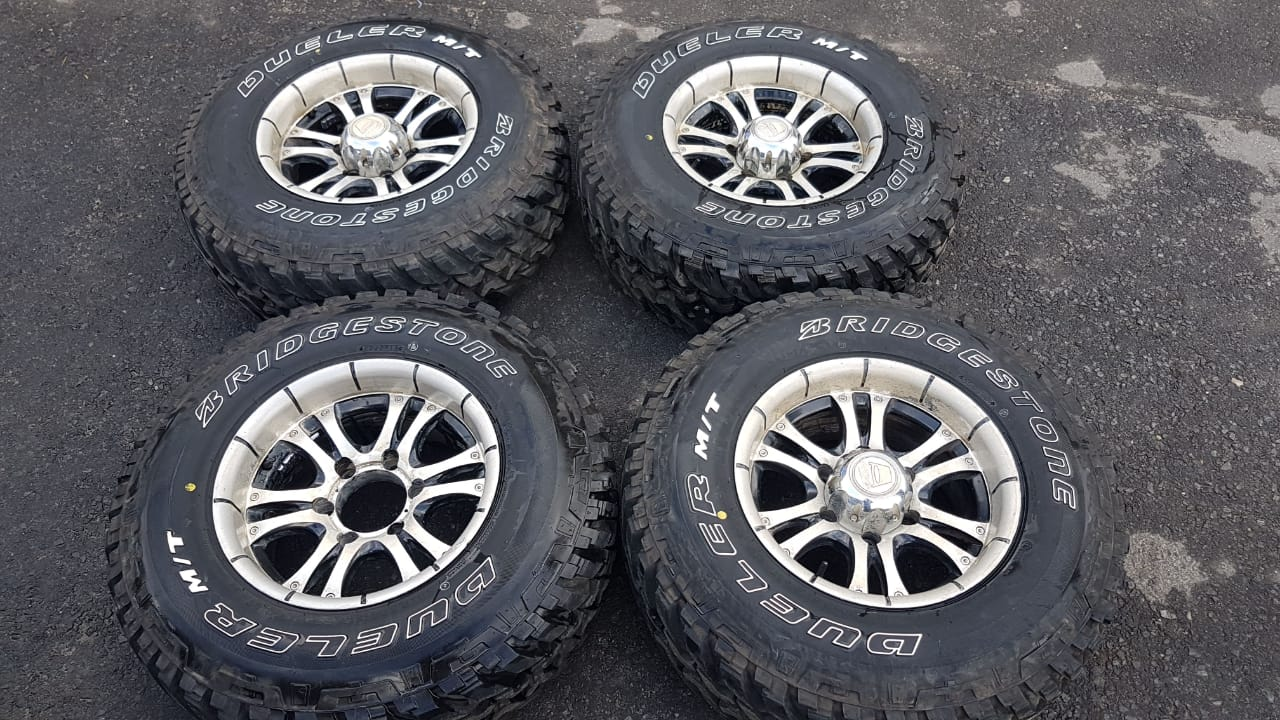 "15"" Rims 6 Hole Bridgestone - Dueler tyres for sale."
