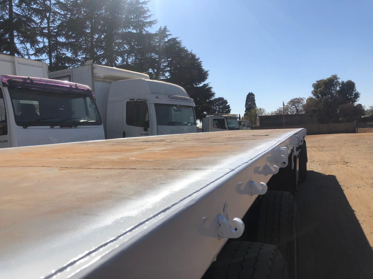 Super link flat deck trailer
