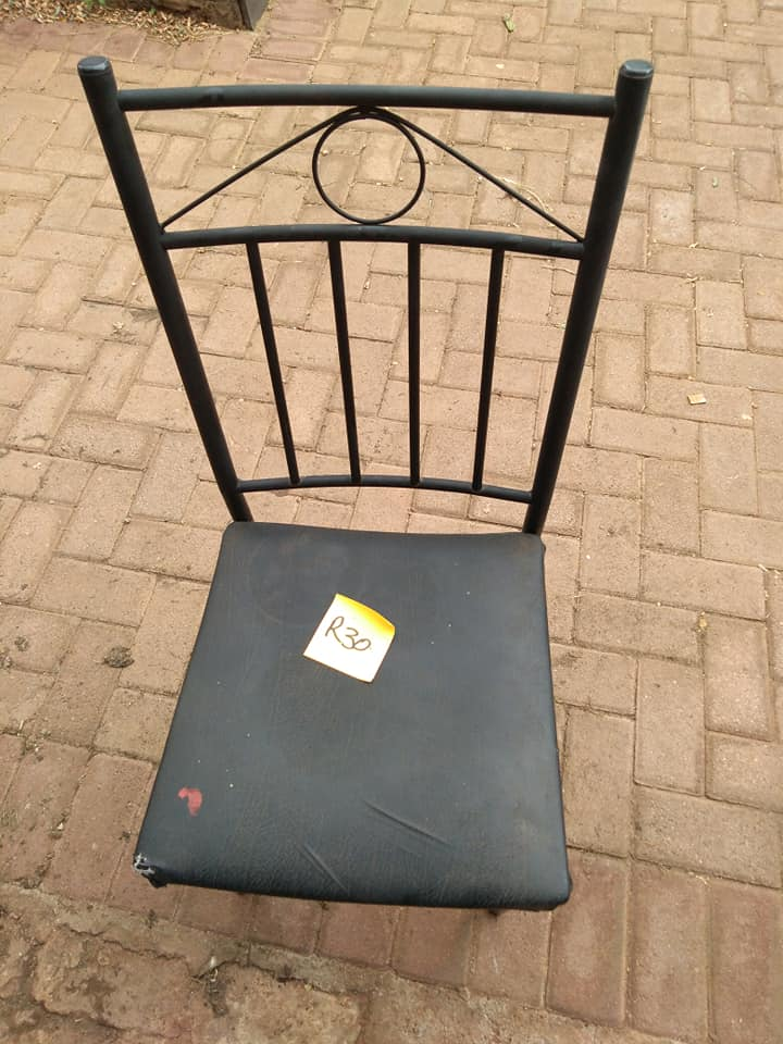 Steel back chair for sale