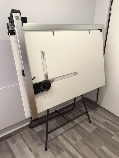 Architects drawing board on tubular stand