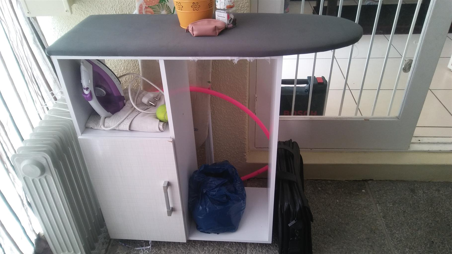 Ironing board with cabinet