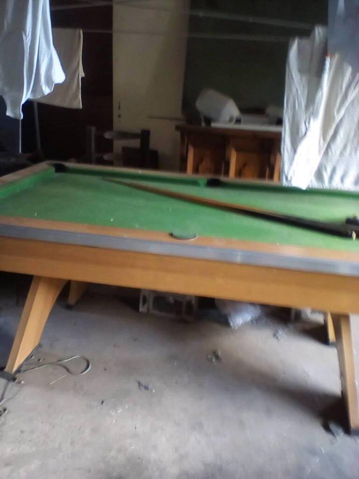 Old pool table with cue for sale