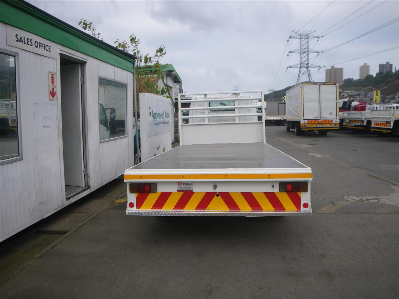 Driving school truck with flatbed body