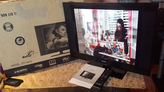 19inch Aim flat screen tv with remote and box, plays Hdmi, Vga, Usb and Rc, neat condition
