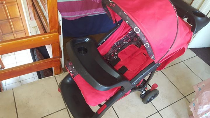 Red pram for sale
