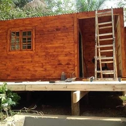 AFRICA LOG HOME CONTAINERS