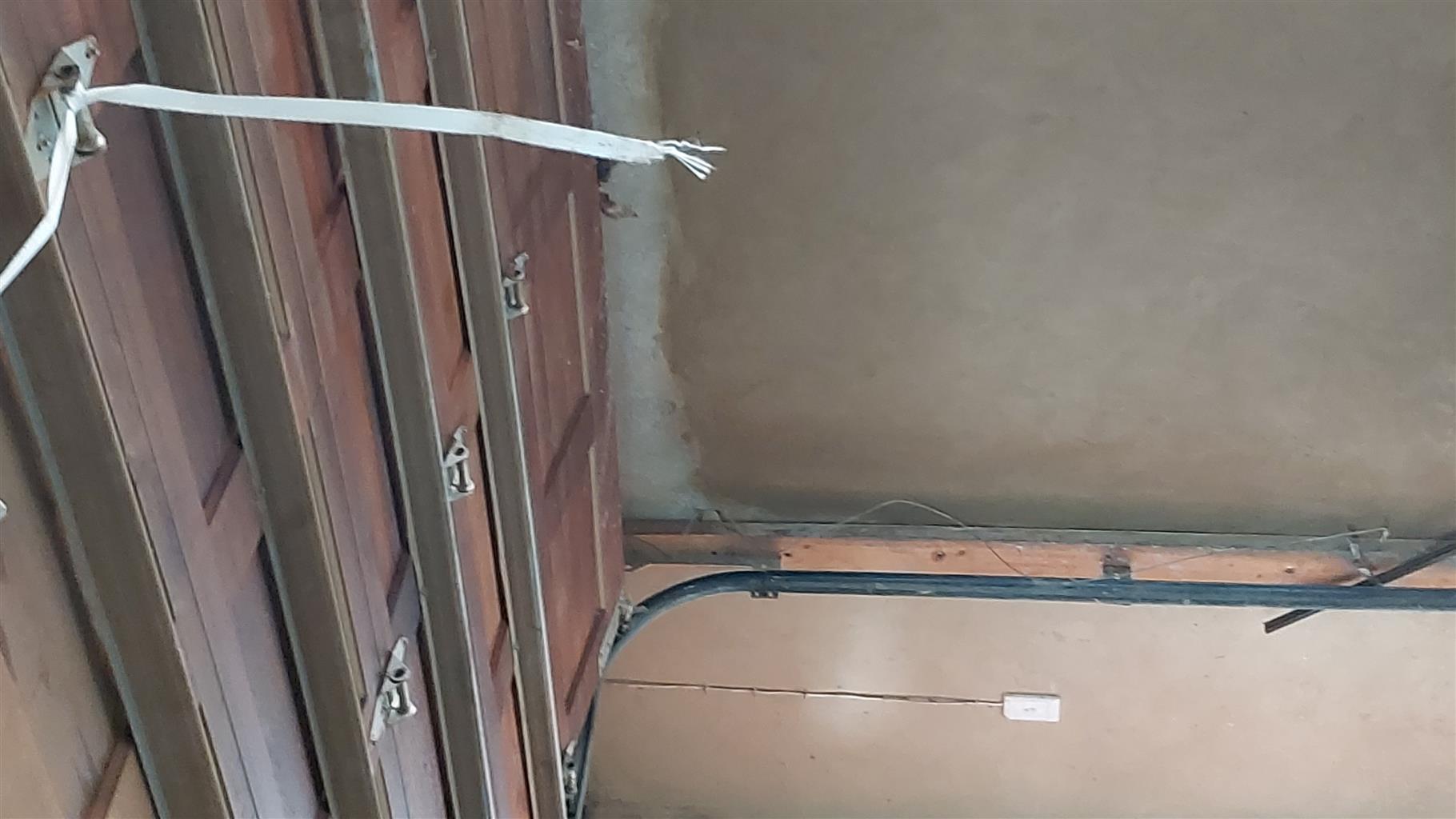 Dooble Wooden garage Door and a Motor