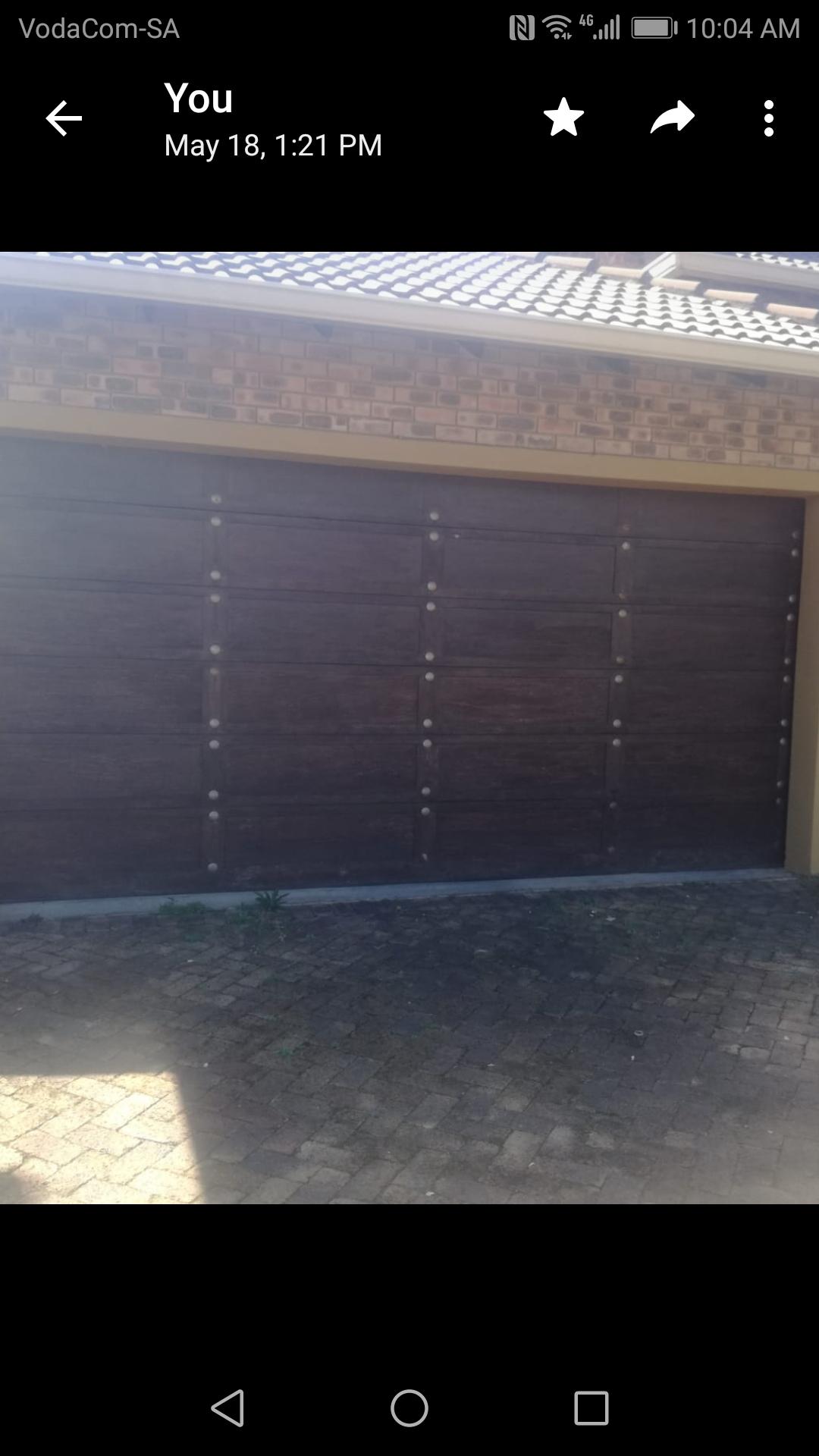 Complete double wooden garage door with hardware in good condition