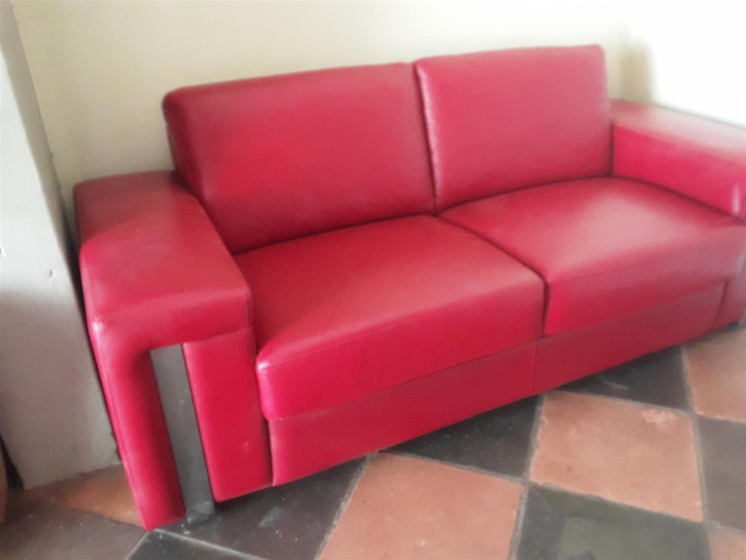 Two-seater leather lounge suite