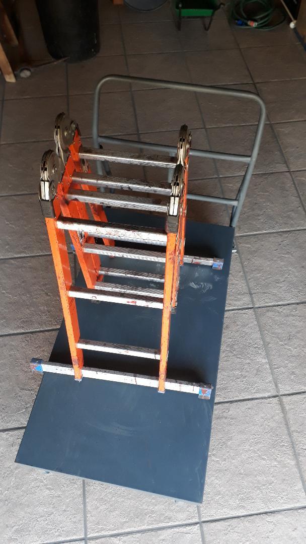 Flatbed EEZEEROLL trolley & 4 fold aluminium ladder.   Excellent condition.