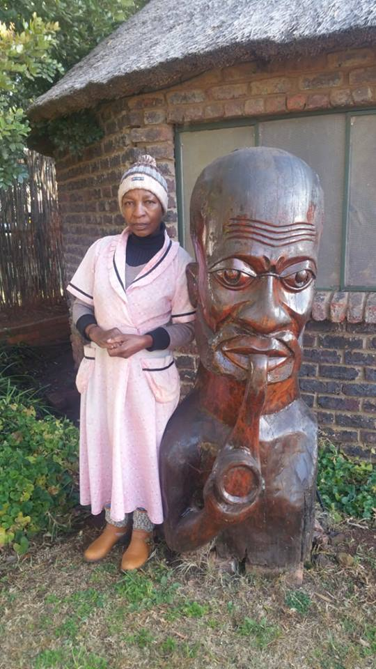 Large african pipe smoking statue