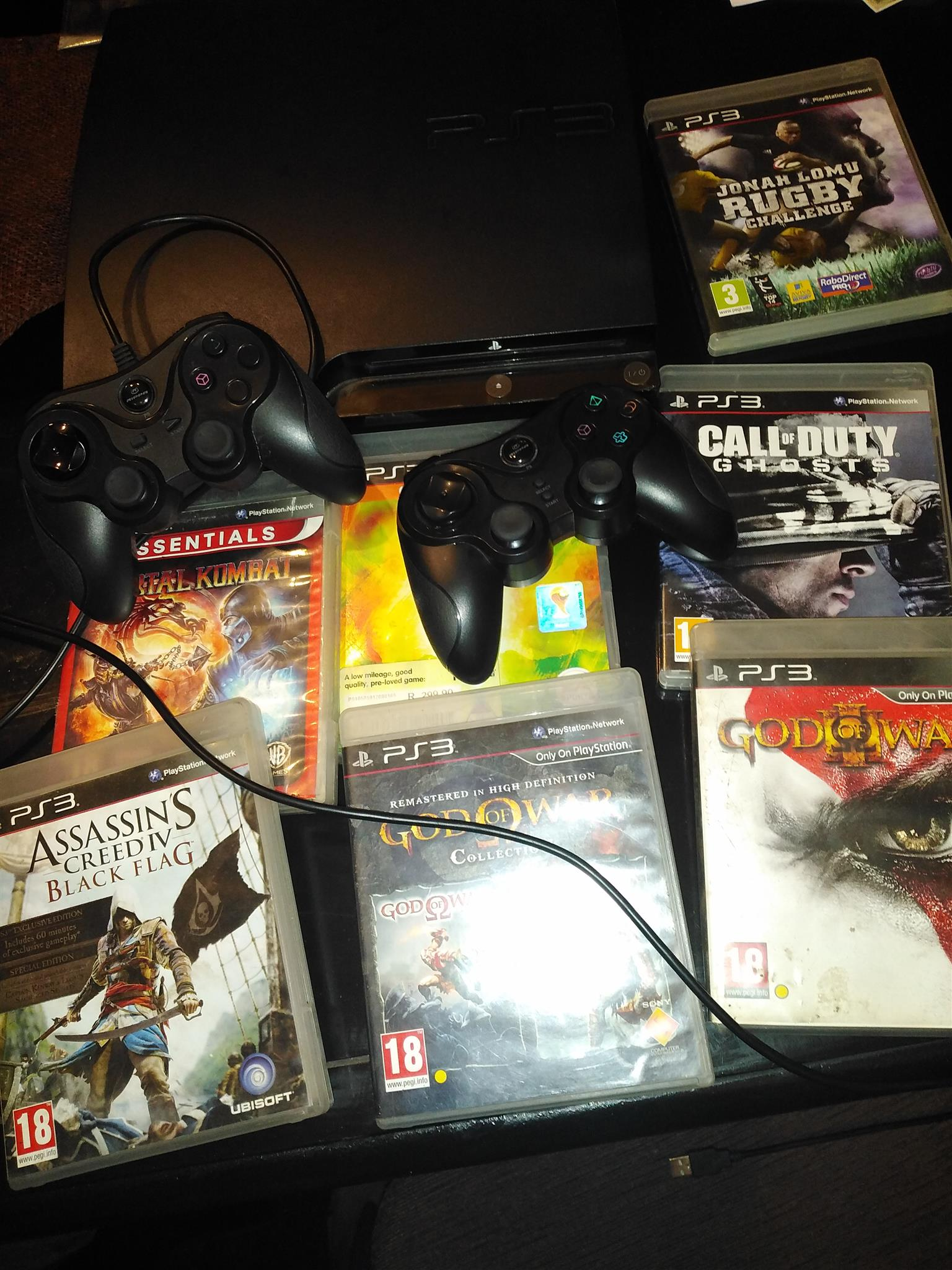 Ps3 500gb with 7 original games & 2 controllers.
