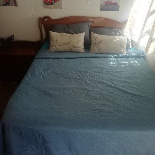 Queen size bed with side tables and head board