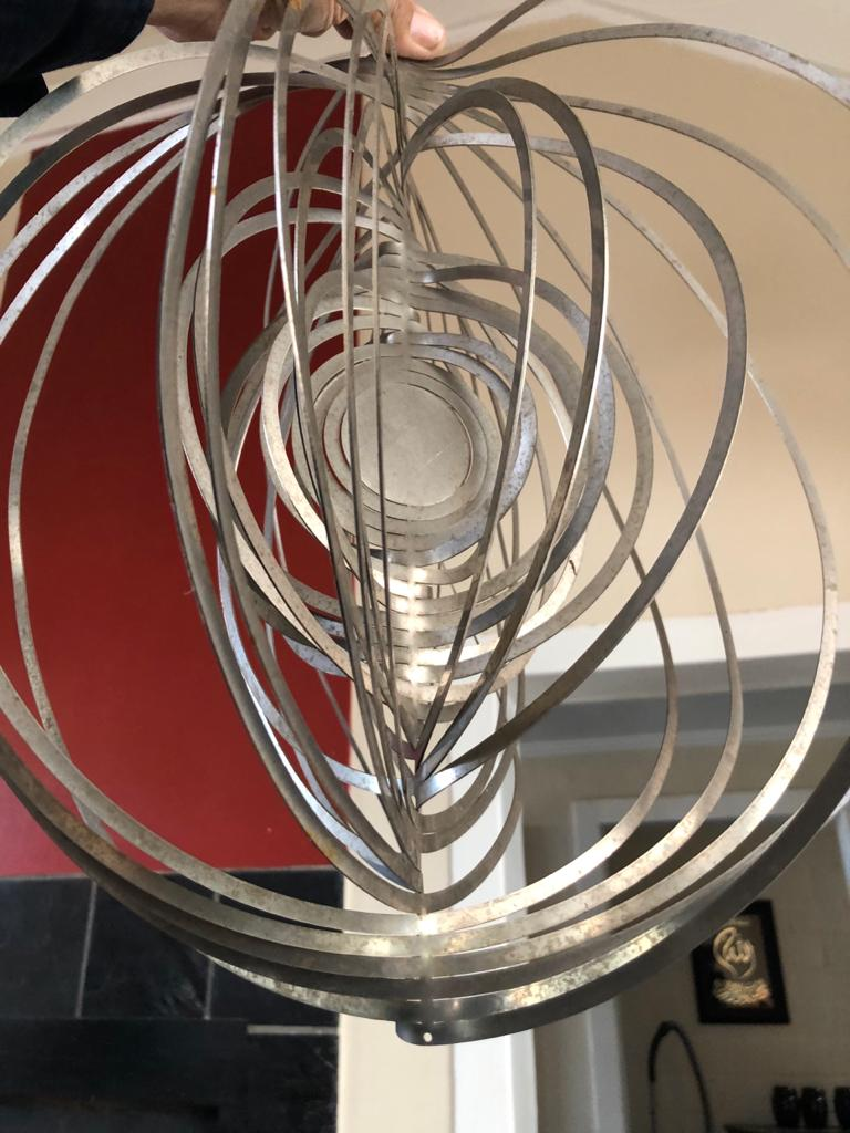 Unique Sheet metal hanging art work for a double volume vertical space