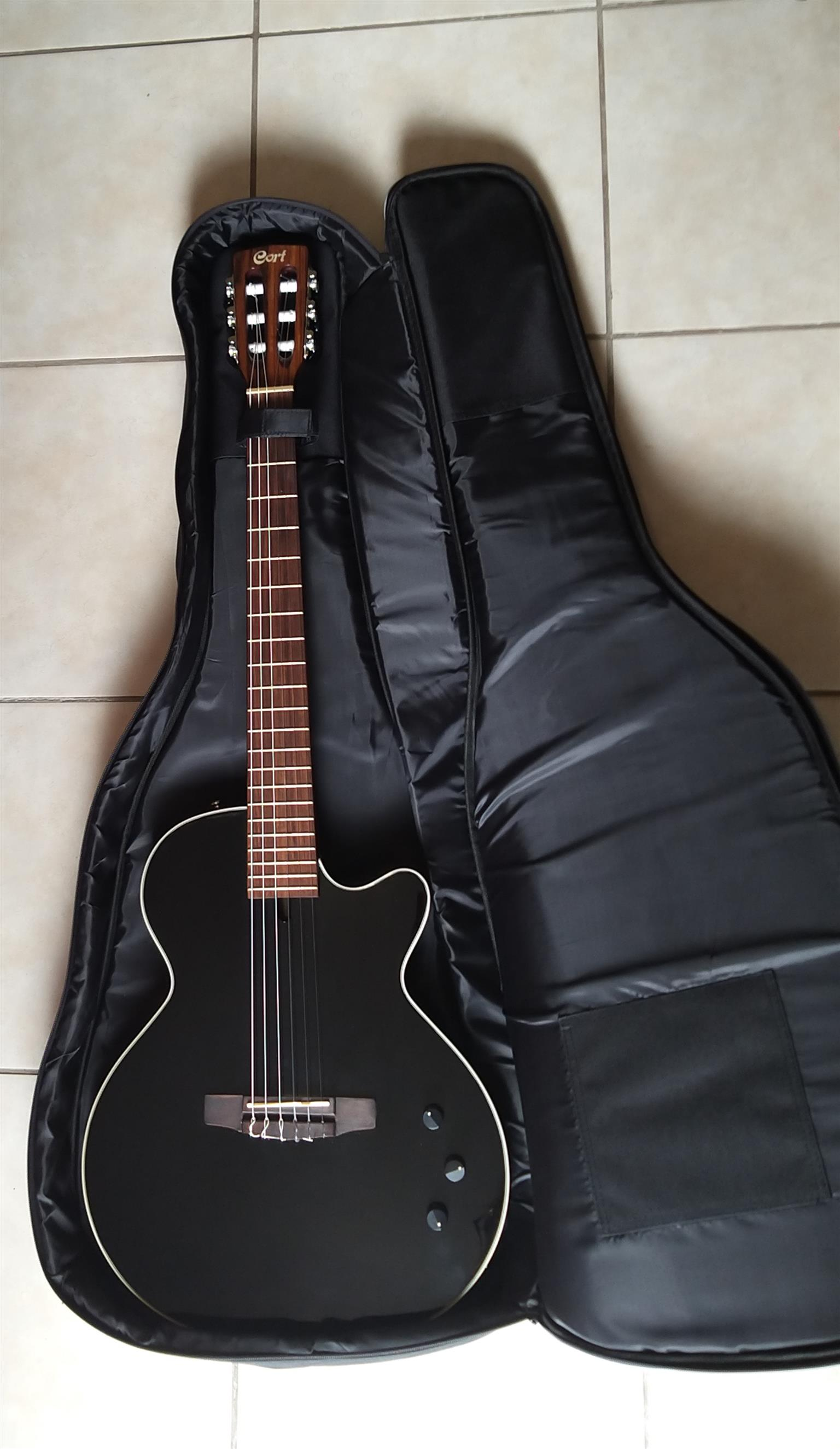 Cort Classical Nylon String Electric Guitar with bag included.