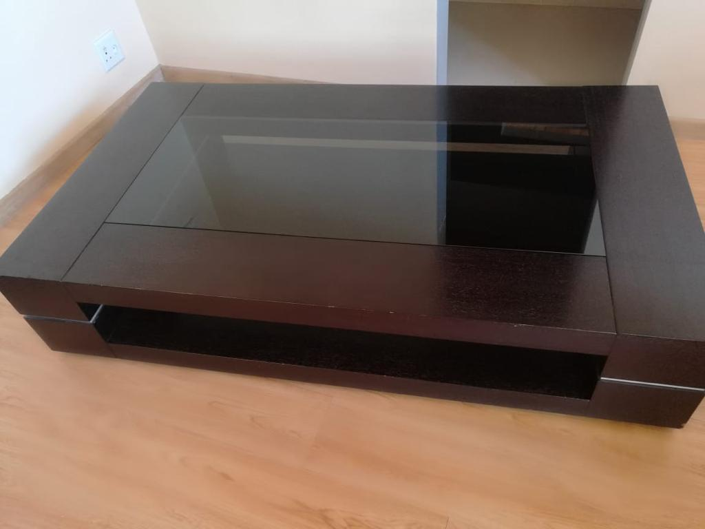 Stunning dark wood coffee table with glass insert priced to go