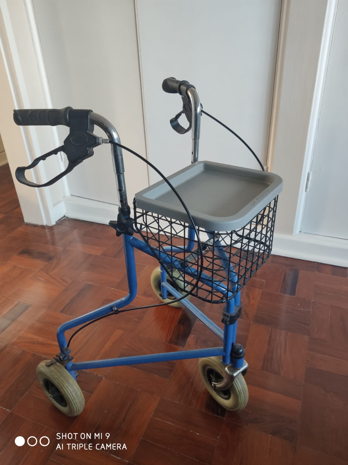 Orthopedic walker with wheels