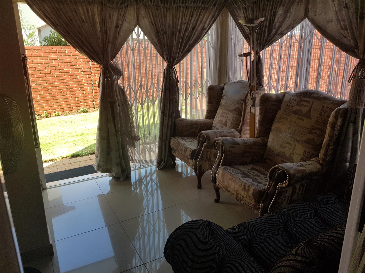 Upmarket 4 bedroom, 4 bathroom townhouse with double garage in Hazeldean, Pretoria.