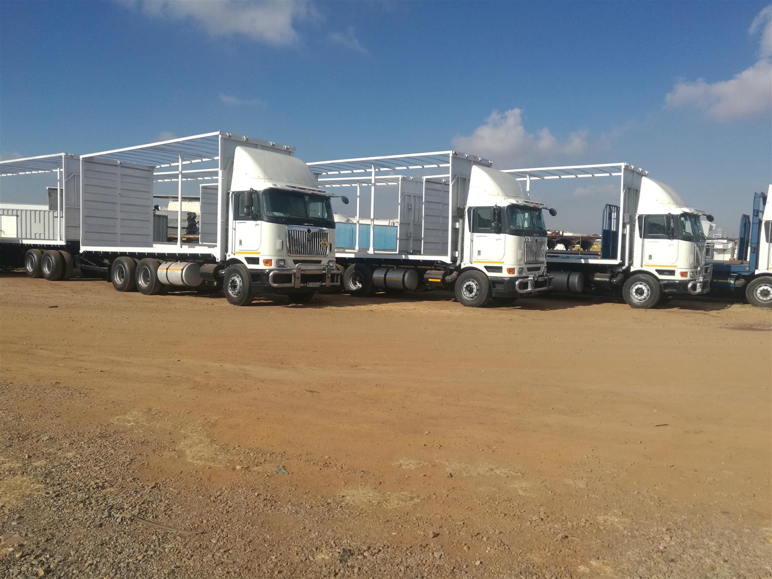 INTERNATIONAL SUPELINK FLATBED AND TUATLINERS FOR SALE. POSTED MUHAMMAD