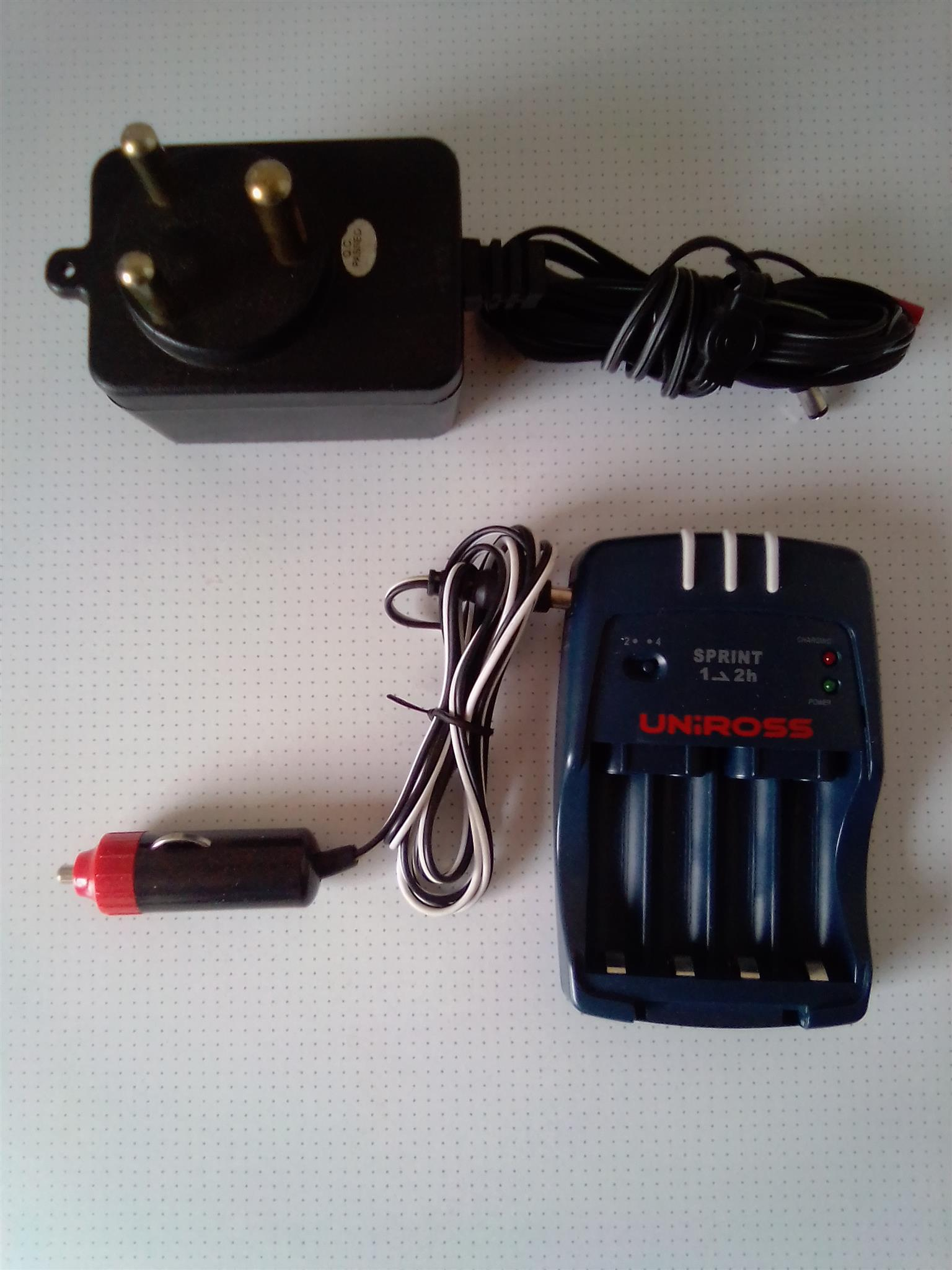 Charger for AA and AAA Batteries. Works on 220V and 12V.
