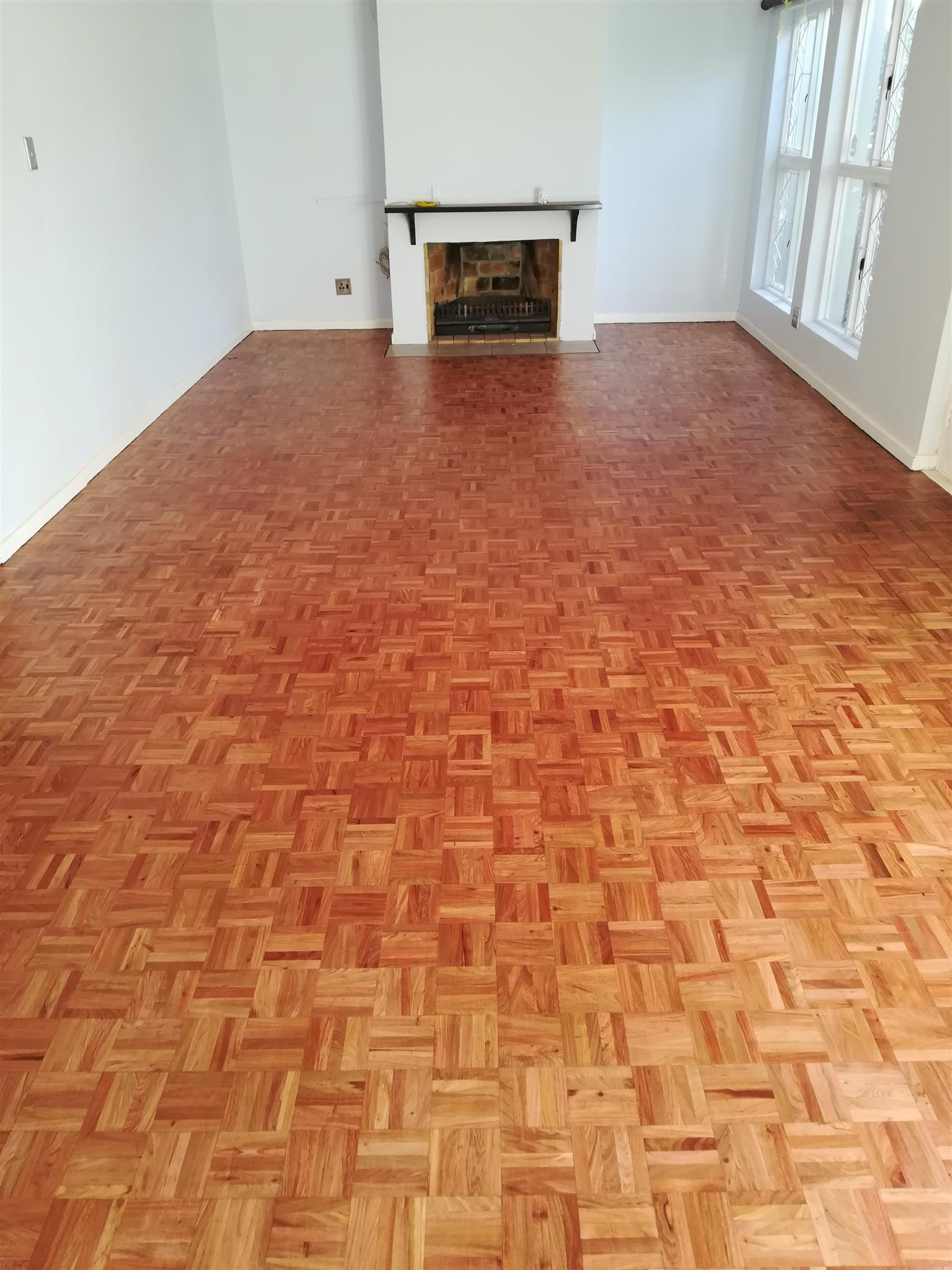 Sanding and sealing of all wooden flooring