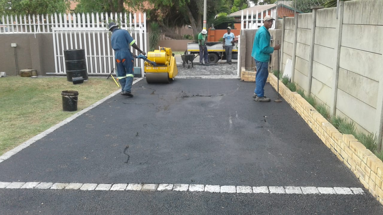 Tar surfacing and tennis courts