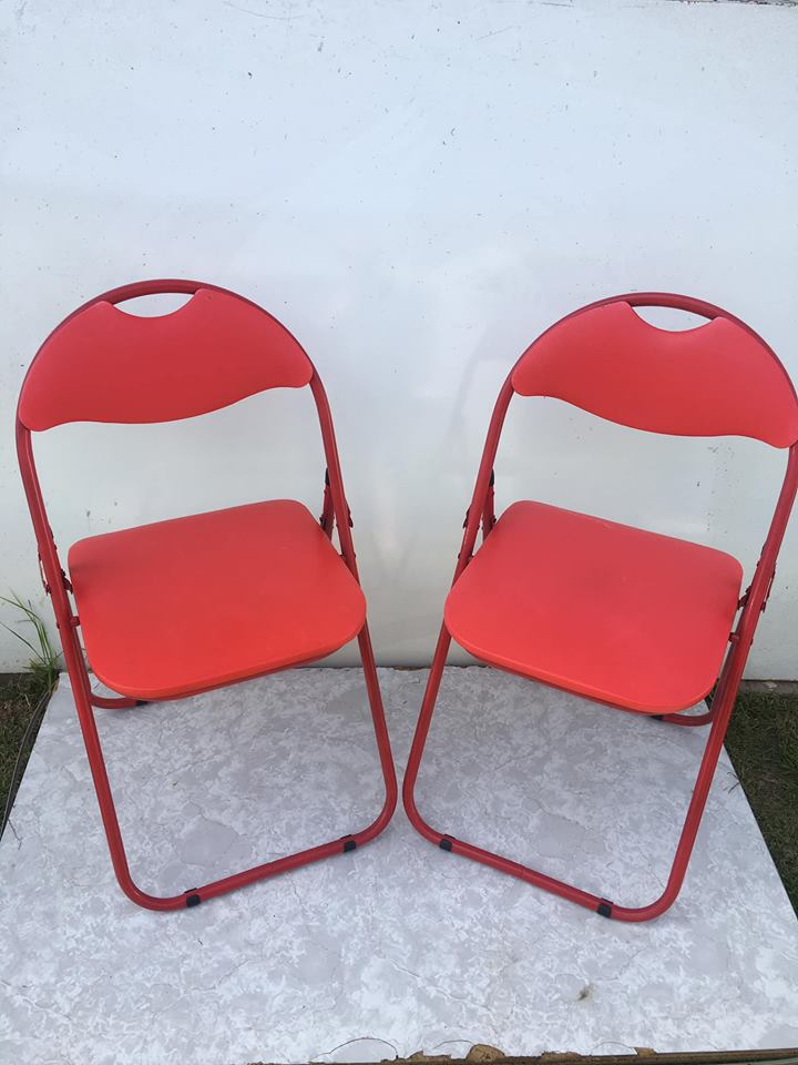 Red fold up chairs