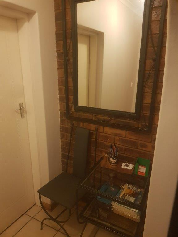 Wrought Iron Chair, Mirror and Shelves (Telephone Nook)