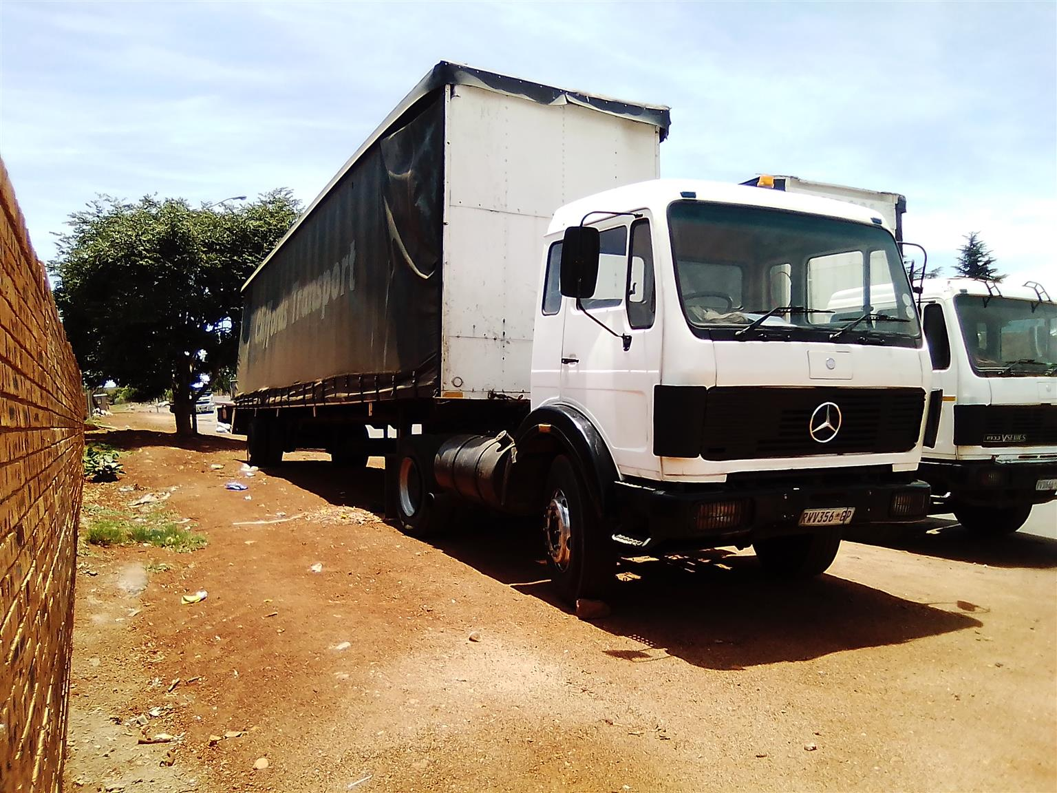 Mercedes Benz truck and trailer with work