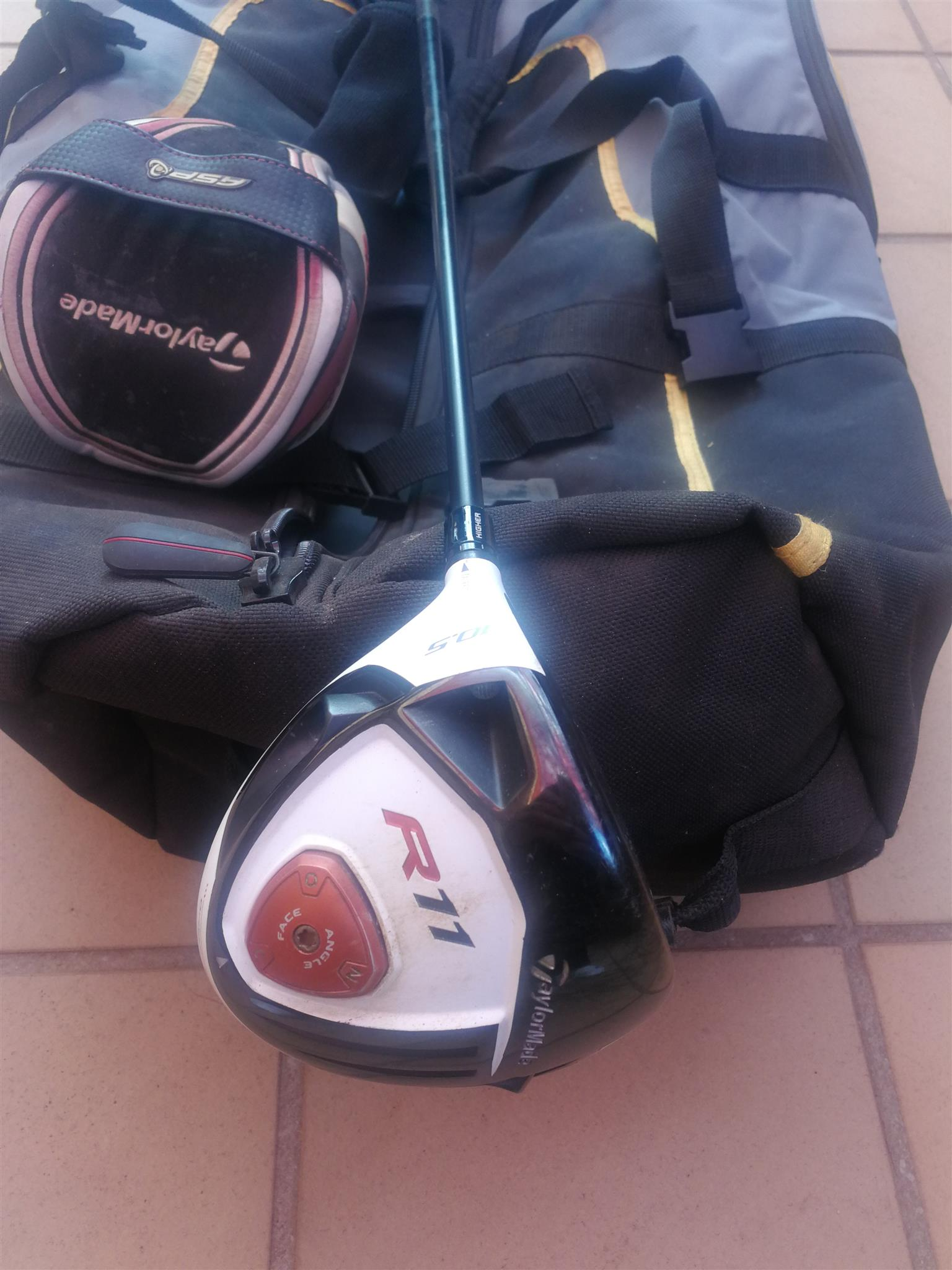 Left handed R11, Taylor made driver, plus golf travel bag