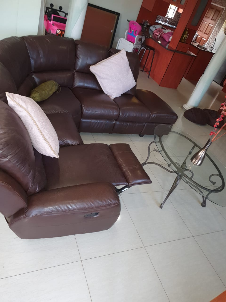 Leather Upper 6 Seater, storage ottoman and glass coffee table for sale