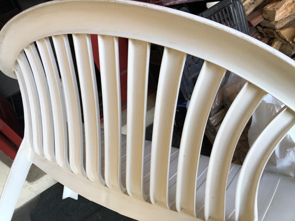 White plastic bench - ideal for a patio / stoep