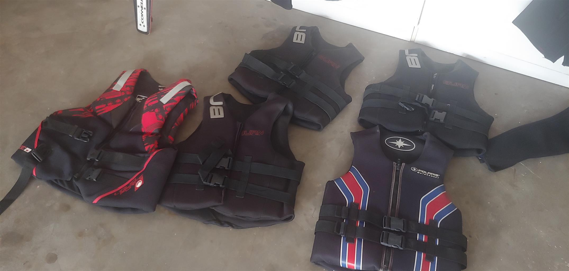 Wet suits, life jackets and ski