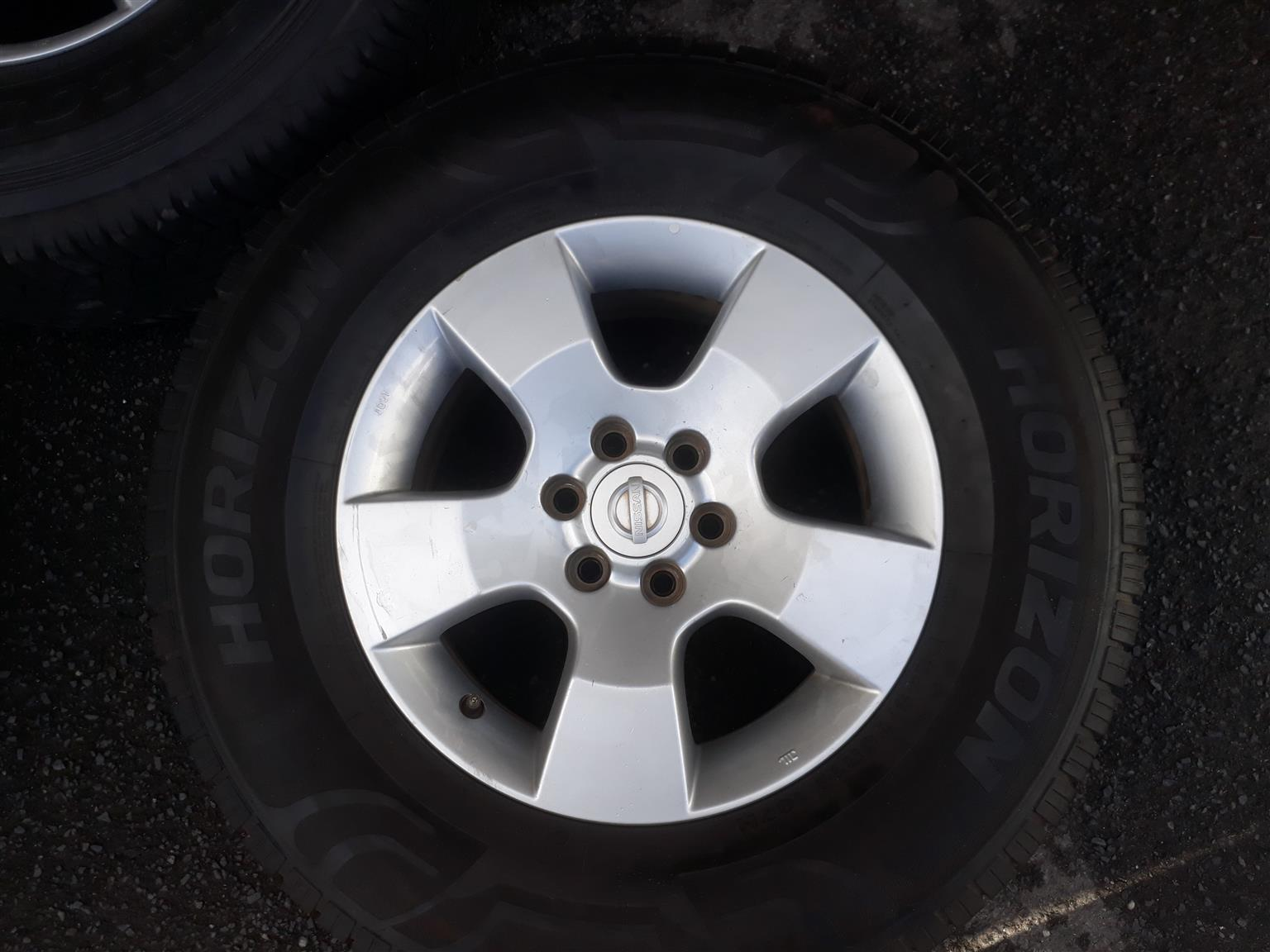 Nissan Navara 16 inch Mag wheel and tyre, two left for sale!! Price negotiable!! Extra for free when buying the two mags will be a steel rim c/w tyre and an extra tyre.